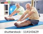 elderly couple stretching in... | Shutterstock . vector #114143629