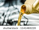pour motor oil to car engine.... | Shutterstock . vector #1141483220