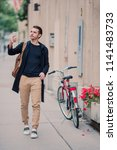 man tourist with smartphone in... | Shutterstock . vector #1141483733
