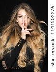 model with long blonde waving... | Shutterstock . vector #1141502276