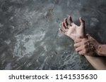man's hand holding a woman hand ... | Shutterstock . vector #1141535630