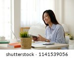 young asian woman working with... | Shutterstock . vector #1141539056