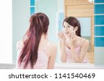 woman use cleansing cotton in... | Shutterstock . vector #1141540469