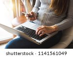 hands of woman using mobile... | Shutterstock . vector #1141561049