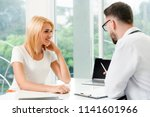 male doctor is talking to... | Shutterstock . vector #1141601966