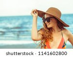 happy young woman wearing... | Shutterstock . vector #1141602800