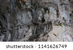 the cave statue of the buddha... | Shutterstock . vector #1141626749