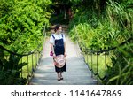 in the summer  a woman in a... | Shutterstock . vector #1141647869
