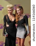 LOS ANGELES, CA - SEPTEMBER 6, 2012: Miley Cyrus & Brandi Cyrus at the 2012 MTV Video Music Awards at Staples Center, Los Angeles. - stock photo