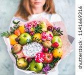 fruit and berries bouquet....   Shutterstock . vector #1141669316