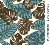 tropical leaves. seamless... | Shutterstock .eps vector #1141705493