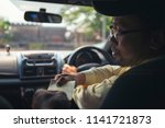customer paying for taxi. cash... | Shutterstock . vector #1141721873