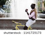 handsome young afro american...   Shutterstock . vector #1141725173