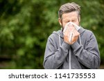 man with cold or hay fever... | Shutterstock . vector #1141735553
