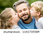 happy children give father a... | Shutterstock . vector #1141735589