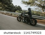 man in black leather jacket... | Shutterstock . vector #1141749323