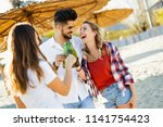 group of young friends laughing ... | Shutterstock . vector #1141754423
