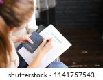girl filling visa application... | Shutterstock . vector #1141757543
