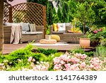 wooden terrace with couch with... | Shutterstock . vector #1141764389