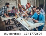 college students using laptop... | Shutterstock . vector #1141772609