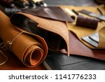 pieces of leather on table | Shutterstock . vector #1141776233