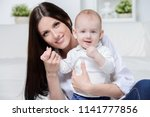 happy young mother playing with ... | Shutterstock . vector #1141777856