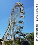 ferris wheel with blue sky at a ... | Shutterstock . vector #1141784756