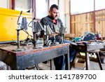 sculptor is making creative... | Shutterstock . vector #1141789700