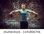 fitness man exercising with...   Shutterstock . vector #1141806746