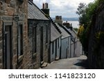 narrow street with stone houses ... | Shutterstock . vector #1141823120