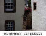 narrow street with white houses ... | Shutterstock . vector #1141823126