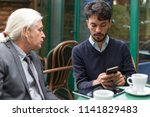 colleagues at the coffee shop | Shutterstock . vector #1141829483