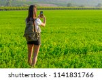 a tourist hiker with backpack... | Shutterstock . vector #1141831766