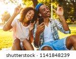 portrait of a joyful young... | Shutterstock . vector #1141848239