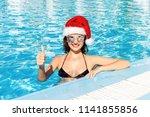 happy girl face in christmas... | Shutterstock . vector #1141855856