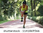 female runner suffering with... | Shutterstock . vector #1141869566