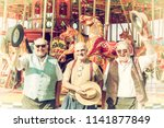 three fairground workers at a...   Shutterstock . vector #1141877849