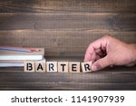Small photo of Barter concept. Wooden letters on the office desk, informative and communication background