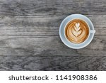 a beautiful cup of cappuccino... | Shutterstock . vector #1141908386
