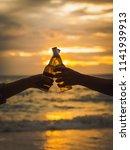 couple hands holding beer... | Shutterstock . vector #1141939913