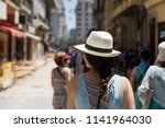 pretty young woman with hat on... | Shutterstock . vector #1141964030