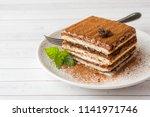 delicious tiramisu cake with... | Shutterstock . vector #1141971746