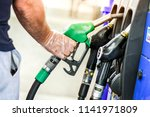 man is holding a gasoline fuel... | Shutterstock . vector #1141971809
