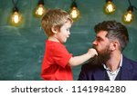 teacher with beard  father and... | Shutterstock . vector #1141984280