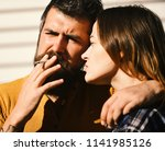 man and woman with serious... | Shutterstock . vector #1141985126