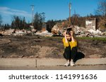 sad woman owner holds his head... | Shutterstock . vector #1141991636
