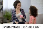 mum telling daughter about... | Shutterstock . vector #1142011139