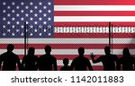 usa flag behind secure fence   Shutterstock . vector #1142011883