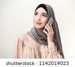 modern arab woman talking on... | Shutterstock . vector #1142019023