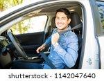 portrait of handsome young man... | Shutterstock . vector #1142047640